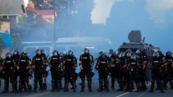 Security forces take position during a protest against the death in Minneapolis