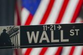 Dow Hits Record High Lifting US Stocks as Nasdaq Continues Slide