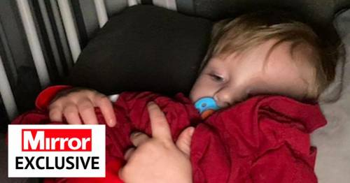 Boy, 2, hugs dad's T-shirt every night waiting for him to be freed from prison