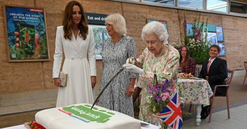 Queen insists on borrowing ceremonial sword to cut cake with Kate spotted laughing