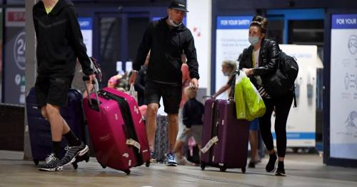 Exhausted Portugal tourists arrive in UK with hours to spare before amber change