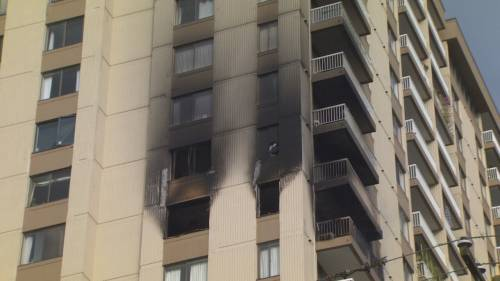 Neighbours come together to carry elderly woman to safety during Vancouver highrise fire