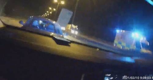 Woman driving wrong way down M25 glugging wine tried to bite cops who stopped her