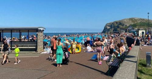 Children 'turning blue' in outdoor pools as sizzling temperatures melt paint