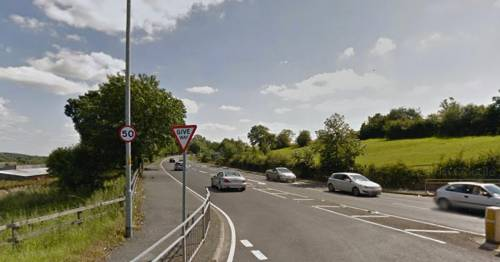 Woman robbed of BMW by two men in layby after stopping to read text message