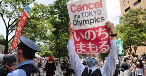 Tokyo Olympics protests as activists lock down streets before opening ceremony - World News