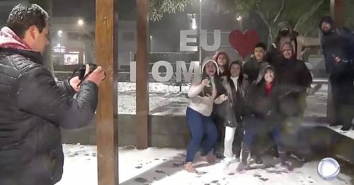 Astonished locals build snowmen and throw snowballs as cold snap freezes Brazil - World News