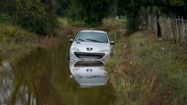 Flash flood submerges southern French villages, fields