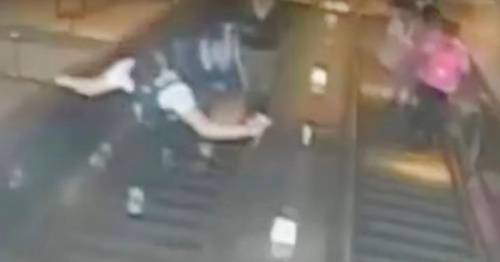 Man high-kicks woman down escalator over 'say excuse me' comment when he barged past