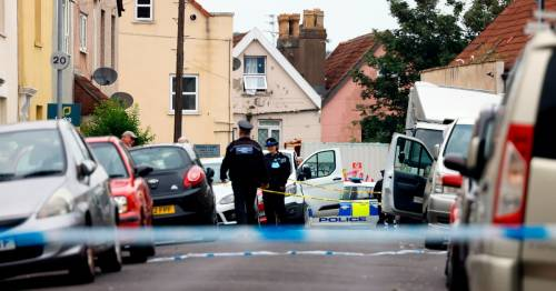 Two men charged with murder as bodies found in house after 'smell filled road'