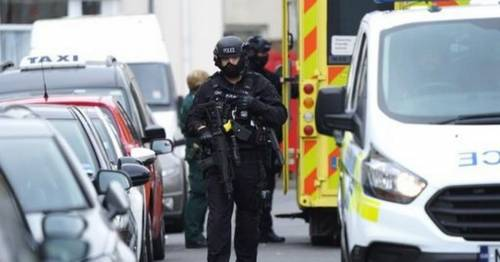 Man 'armed with machete jumps out of window' as armed police called out