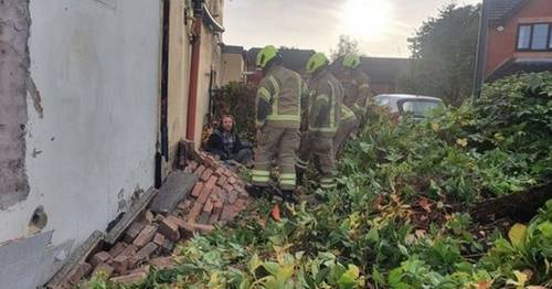 Bike helmet saves man's life after 10ft wall collapses and traps him near his home