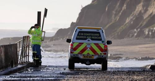 Woman swept out to sea in 40mph gales as flood warnings issued across Britain