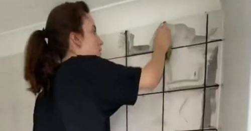 Woman who couldn't afford new bathroom revamps it herself with £60 and sticky tiles