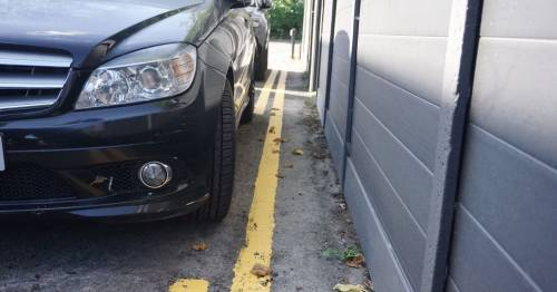 Man furious after 'bullying' council paints yellow lines round wife's parked car