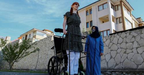 World's tallest woman at over 7ft says 'being different is not as bad as you think' – World News